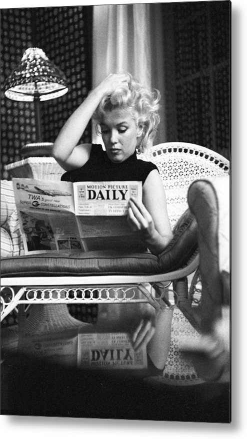 People Metal Print featuring the photograph Marilyn Relaxes In A Hotel Room by Michael Ochs Archives