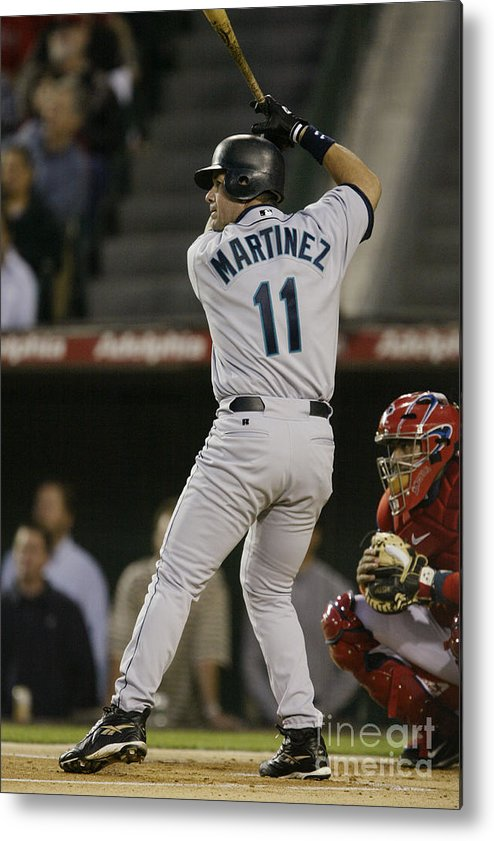 American League Baseball Metal Print featuring the photograph Mariners V Angels by Stephen Dunn