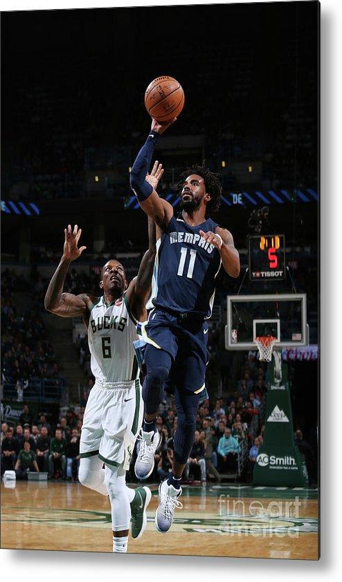 Nba Pro Basketball Metal Print featuring the photograph Memphis Grizzlies V Milwaukee Bucks by Gary Dineen