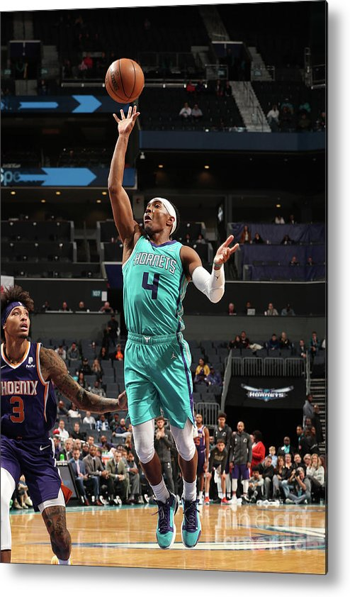 Nba Pro Basketball Metal Print featuring the photograph Phoenix Suns V Charlotte Hornets by Kent Smith