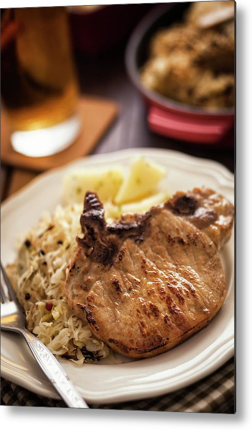Meat Chop Metal Print featuring the photograph Pork Chop And Sauerkraut by Gmvozd