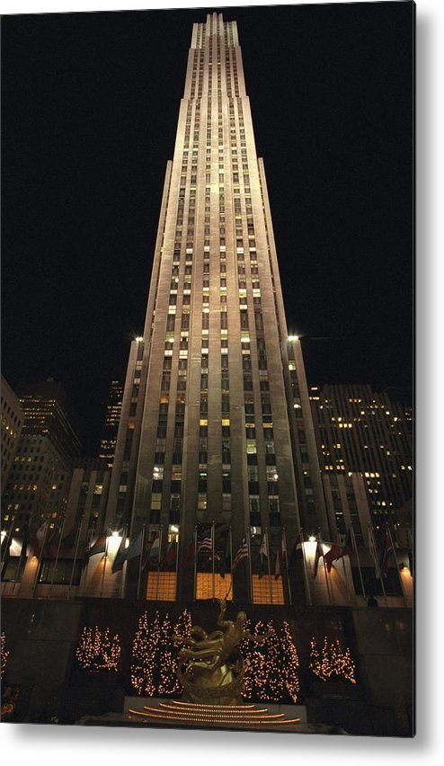 Vertical Metal Print featuring the photograph Rockefeller Center At Night by New York Daily News Archive
