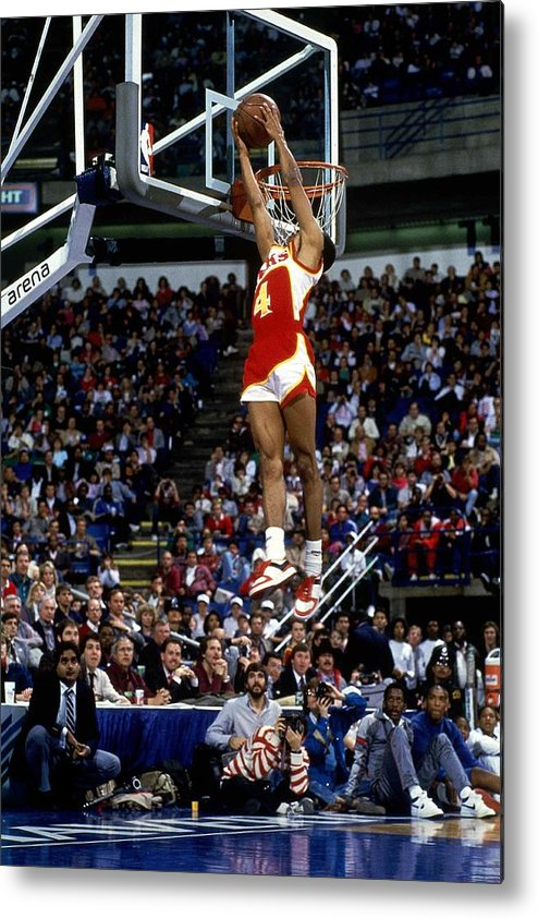 1980-1989 Metal Print featuring the photograph Spud Webb Reverse Dunk Slam Dunk by Andrew D. Bernstein
