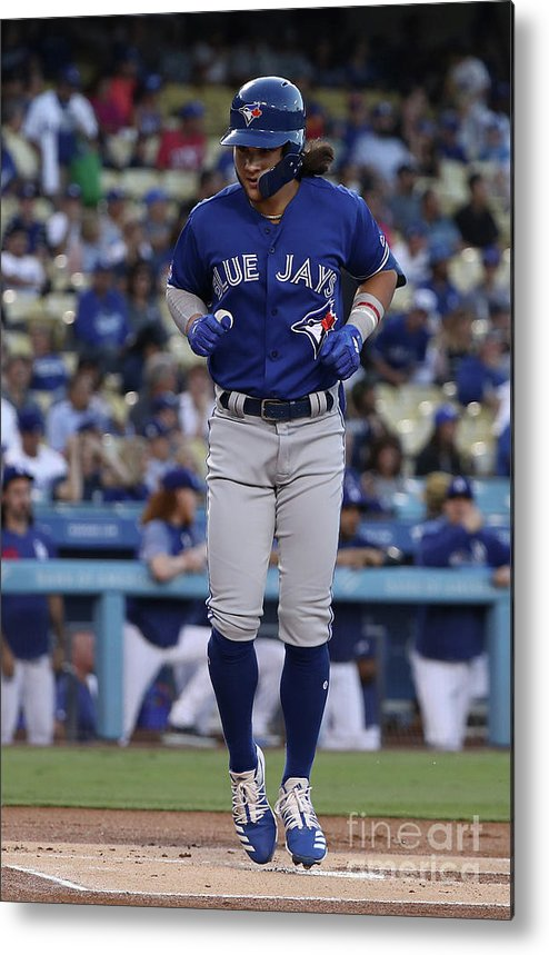 People Metal Print featuring the photograph Toronto Blue Jays V Los Angeles Dodgers by Victor Decolongon