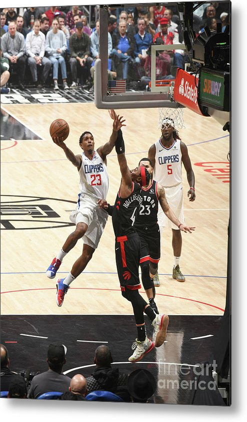 Nba Pro Basketball Metal Print featuring the photograph Toronto Raptors V Los Angeles Clippers by Adam Pantozzi