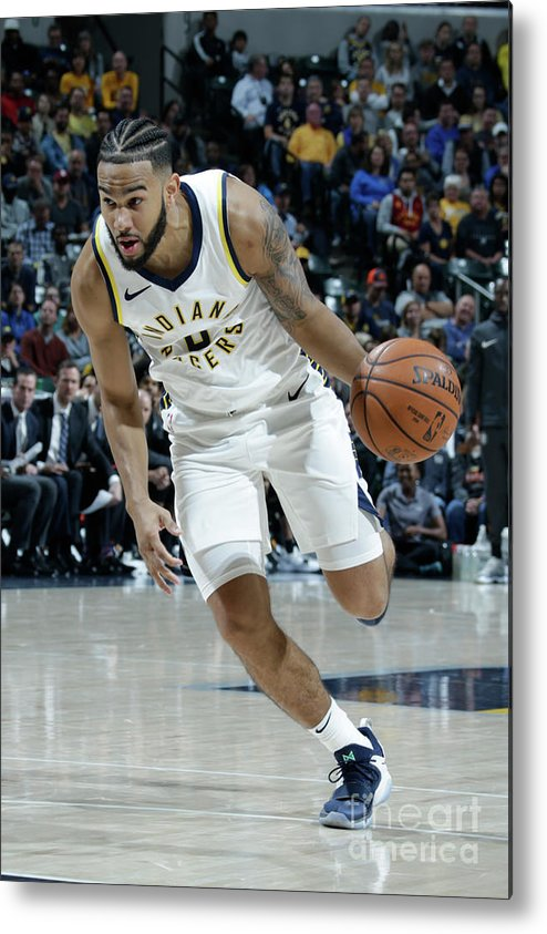 Nba Pro Basketball Metal Print featuring the photograph Cory Joseph by Ron Hoskins