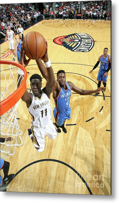 Smoothie King Center Metal Print featuring the photograph Jrue Holiday by Layne Murdoch