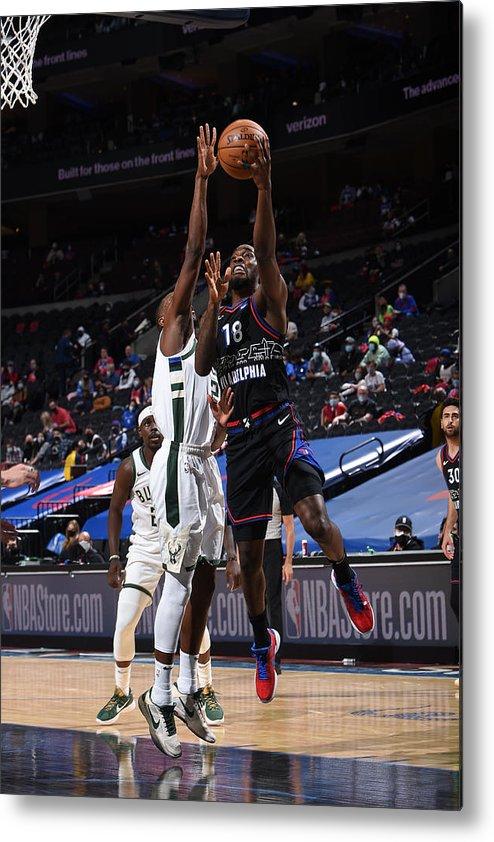 Nba Pro Basketball Metal Print featuring the photograph Milwaukee Bucks v Philadelphia 76ers by David Dow