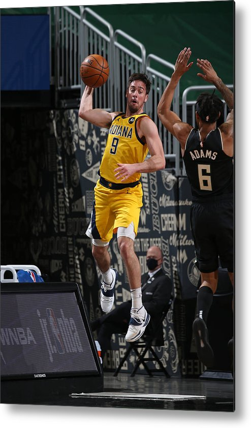 Nba Pro Basketball Metal Print featuring the photograph T.j. Mcconnell by Gary Dineen