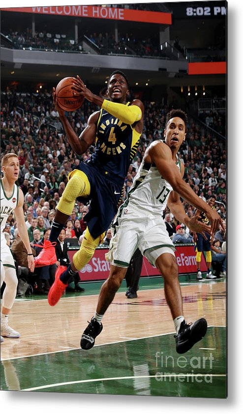 Nba Pro Basketball Metal Print featuring the photograph Victor Oladipo by Gary Dineen