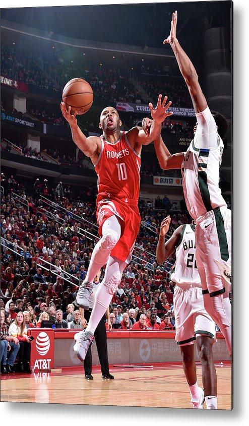 Nba Pro Basketball Metal Print featuring the photograph Eric Gordon by Bill Baptist