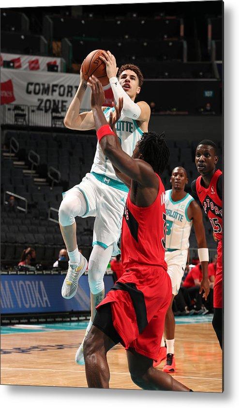 Nba Pro Basketball Metal Print featuring the photograph Toronto Raptors v Charlotte Hornets by Kent Smith