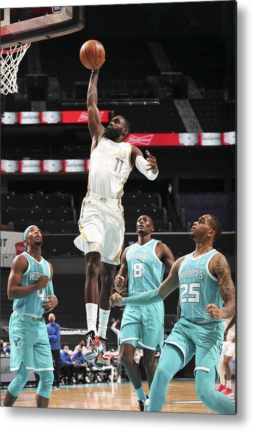 Tim Hardaway Jr. Metal Print featuring the photograph Dallas Mavericks v Charlotte Hornets by Kent Smith