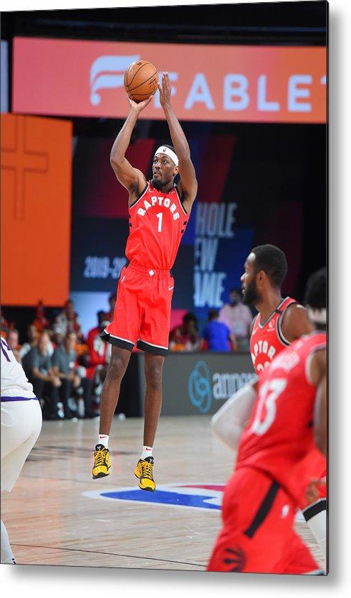 Nba Pro Basketball Metal Print featuring the photograph Toronto Raptors v Phoenix Suns by Bill Baptist