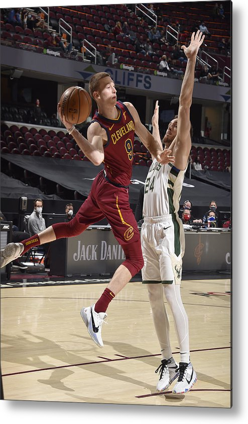 Nba Pro Basketball Metal Print featuring the photograph Milwaukee Bucks v Cleveland Cavaliers by David Liam Kyle