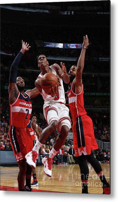 Nba Pro Basketball Metal Print featuring the photograph Rajon Rondo by Gary Dineen