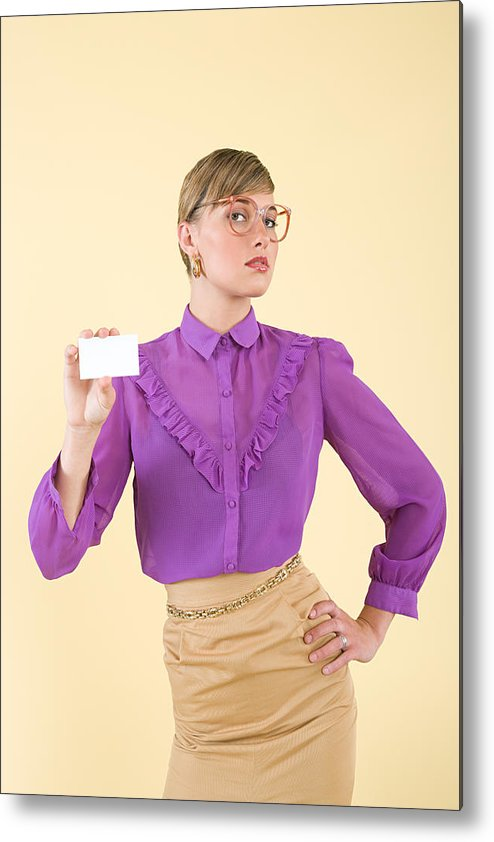 People Metal Print featuring the photograph A woman holding a business card by Image Source