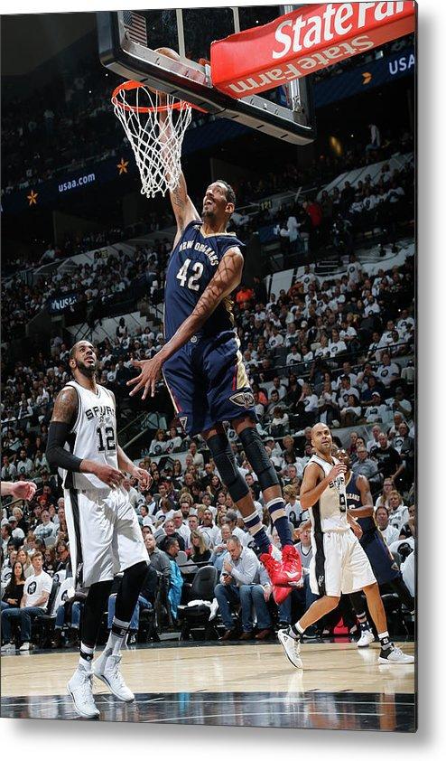 Nba Pro Basketball Metal Print featuring the photograph Alexis Ajinca by Chris Covatta