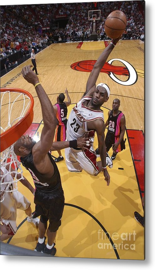 Nba Pro Basketball Metal Print featuring the photograph Alonzo Mourning and Lebron James by Andrew D. Bernstein