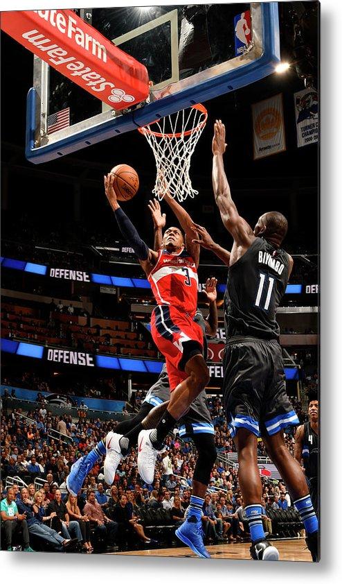 Nba Pro Basketball Metal Print featuring the photograph Bismack Biyombo and Bradley Beal by Fernando Medina