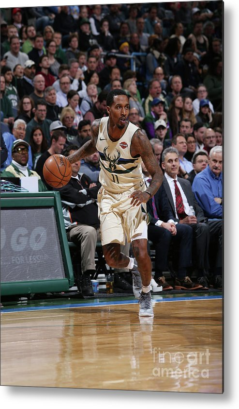 Nba Pro Basketball Metal Print featuring the photograph Brandon Jennings by Gary Dineen
