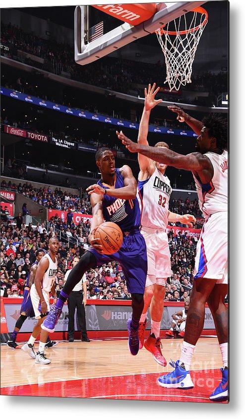 Nba Pro Basketball Metal Print featuring the photograph Brandon Knight by Juan Ocampo