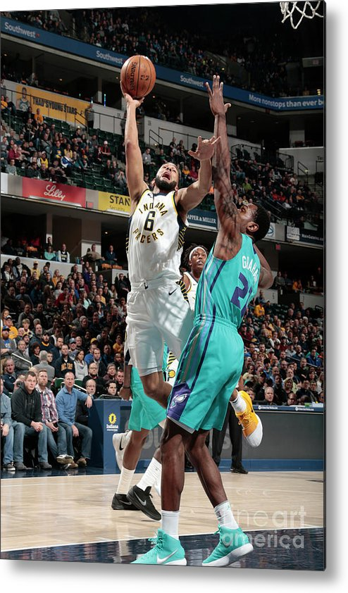 Nba Pro Basketball Metal Print featuring the photograph Cory Joseph by Ron Hoskins
