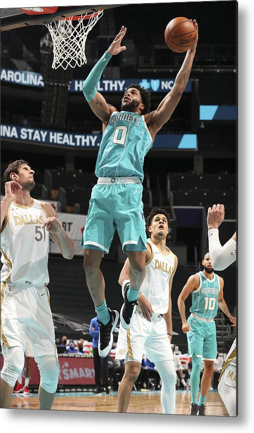 Nba Pro Basketball Metal Print featuring the photograph Dallas Mavericks v Charlotte Hornets by Kent Smith