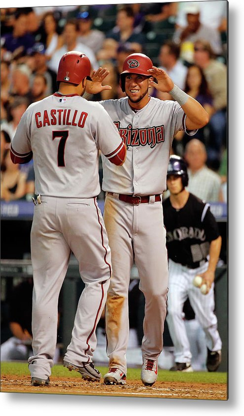 Second Inning Metal Print featuring the photograph David Peralta, Welington Castillo, and Kyle Kendrick by Doug Pensinger