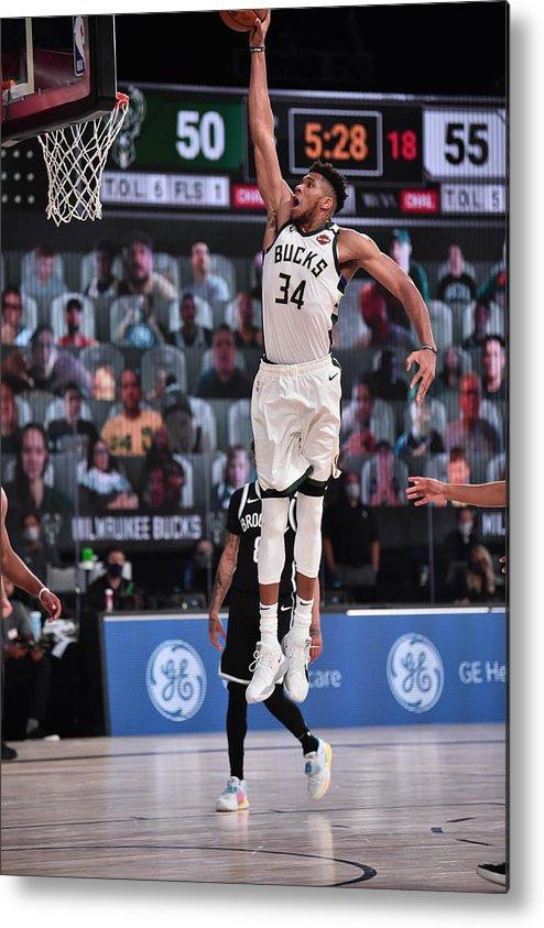 Nba Pro Basketball Metal Print featuring the photograph Giannis Antetokounmpo by David Dow