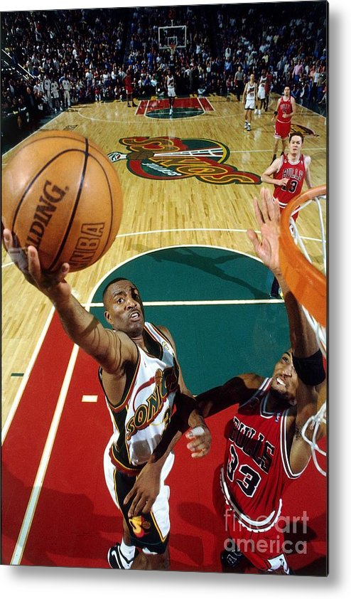 Nba Pro Basketball Metal Print featuring the photograph Hersey Hawkins and Scottie Pippen by Andrew D. Bernstein