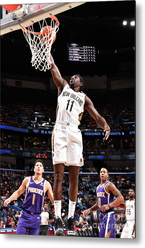 Smoothie King Center Metal Print featuring the photograph Jrue Holiday by Bill Baptist