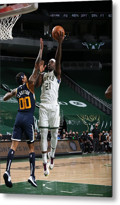 Nba Pro Basketball Metal Print featuring the photograph Jrue Holiday by Gary Dineen