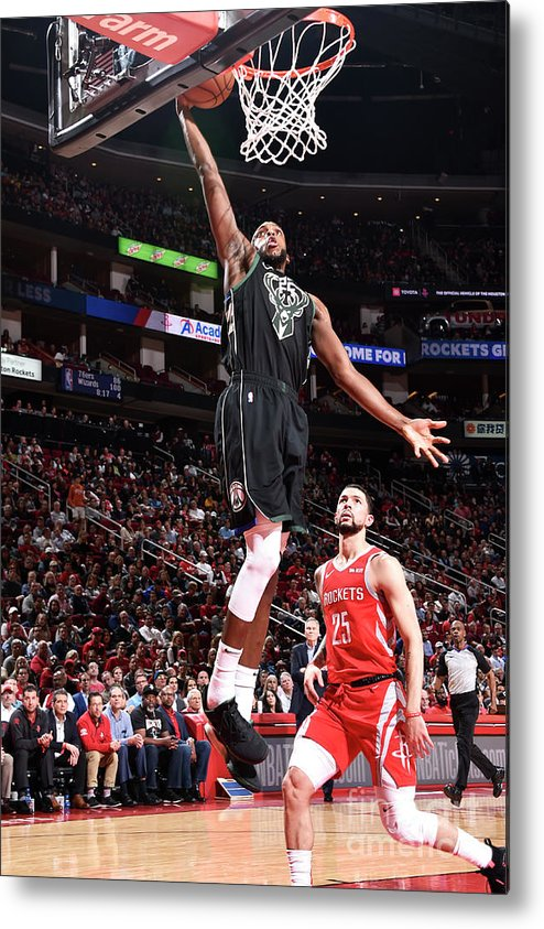 Nba Pro Basketball Metal Print featuring the photograph Khris Middleton by Bill Baptist