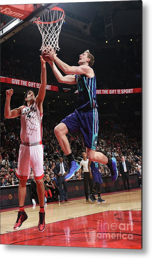 Nba Pro Basketball Metal Print featuring the photograph Luis Scola and Cody Zeller by Ron Turenne