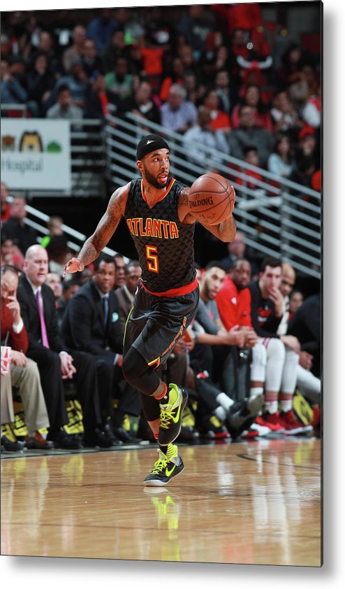 Nba Pro Basketball Metal Print featuring the photograph Malcolm Delaney by Jeff Haynes