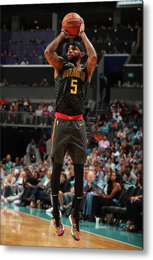 Nba Pro Basketball Metal Print featuring the photograph Malcolm Delaney by Kent Smith