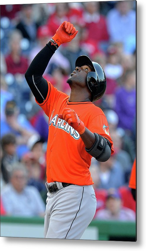 American League Baseball Metal Print featuring the photograph Marcell Ozuna by Greg Fiume