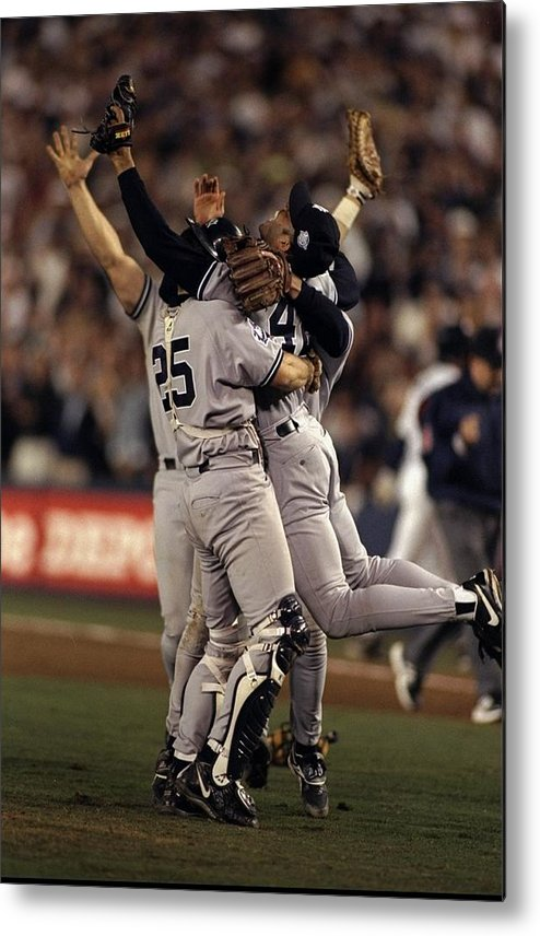 Following Metal Print featuring the photograph Mariano Rivera and Joe Girardi by Al Bello