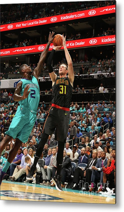 Nba Pro Basketball Metal Print featuring the photograph Marvin Williams and Mike Muscala by Brock Williams-smith
