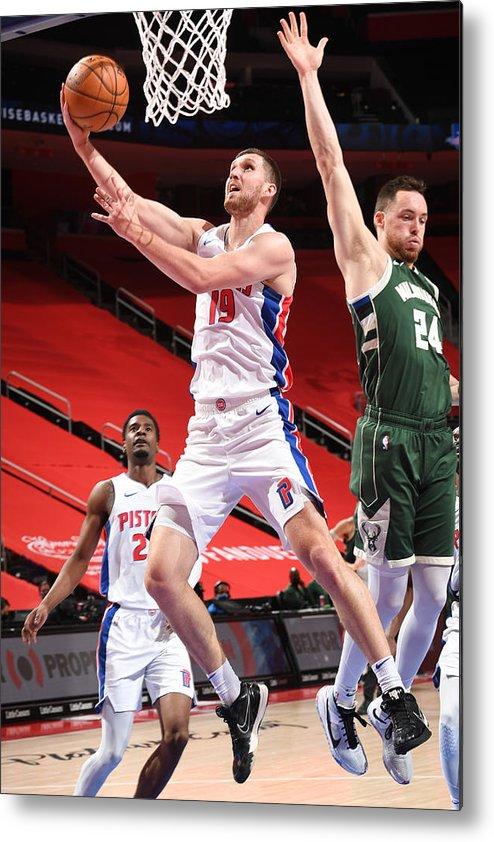 Nba Pro Basketball Metal Print featuring the photograph Milwaukee Bucks v Detroit Pistons by Chris Schwegler