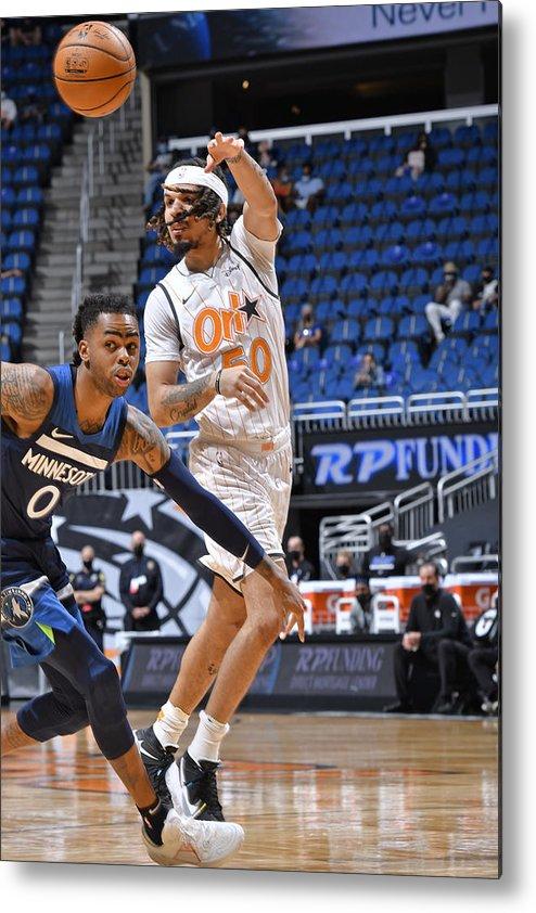 Nba Pro Basketball Metal Print featuring the photograph Minnesota Timberwolves v Orlando Magic by Fernando Medina
