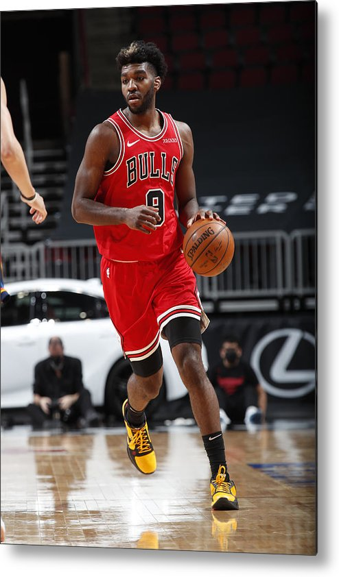 Nba Pro Basketball Metal Print featuring the photograph Oklahoma City Thunder v Chicago Bulls by Jeff Haynes