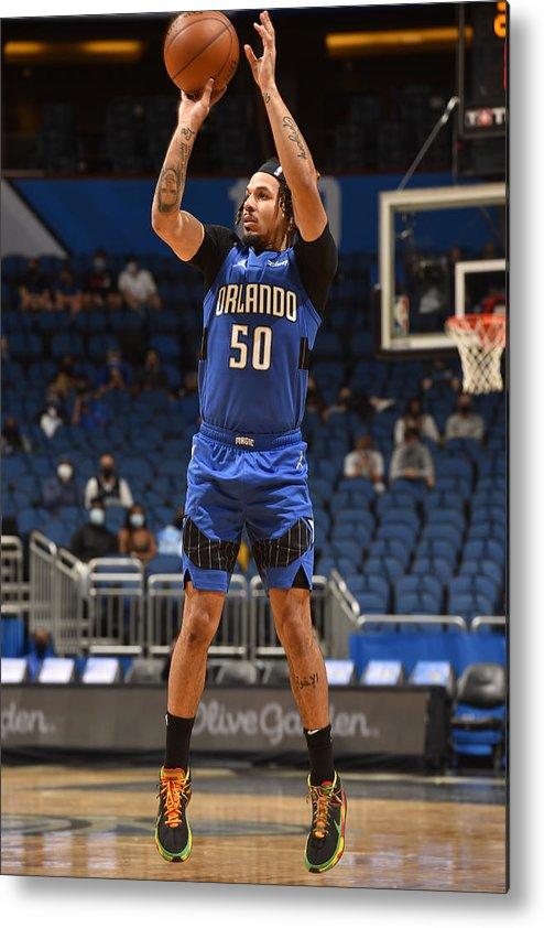 Nba Pro Basketball Metal Print featuring the photograph Oklahoma City Thunder v Orlando Magic by Gary Bassing
