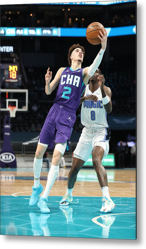 Nba Pro Basketball Metal Print featuring the photograph Orlando Magic v Charlotte Hornets by Brock Williams-Smith
