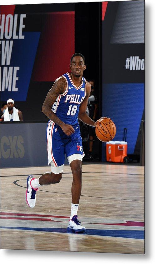 Nba Pro Basketball Metal Print featuring the photograph Orlando Magic v Philadelphia 76ers by Jesse D. Garrabrant