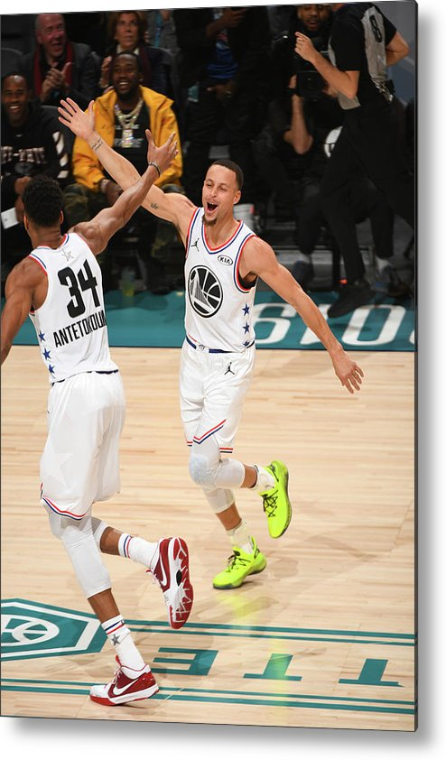 Nba Pro Basketball Metal Print featuring the photograph Stephen Curry and Giannis Antetokounmpo by Garrett Ellwood