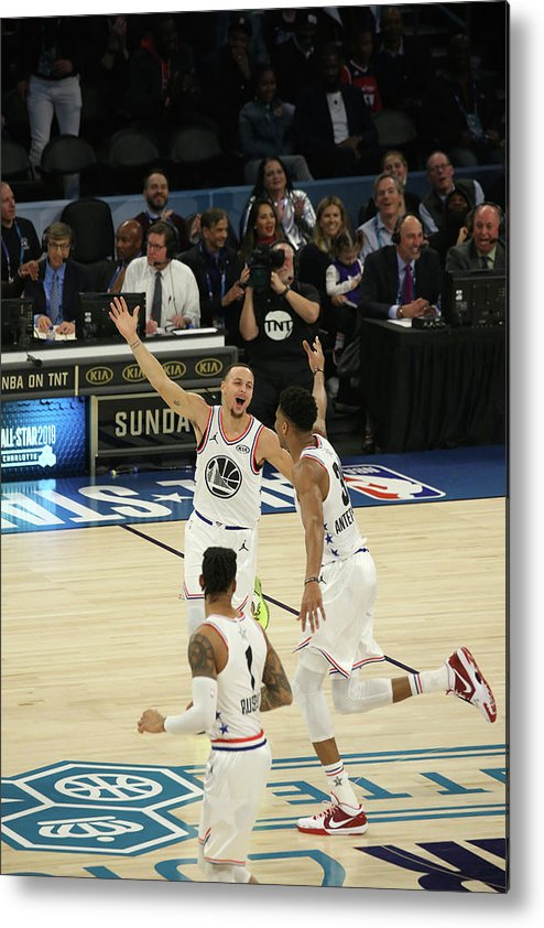 Following Metal Print featuring the photograph Stephen Curry and Giannis Antetokounmpo by Gary Dineen