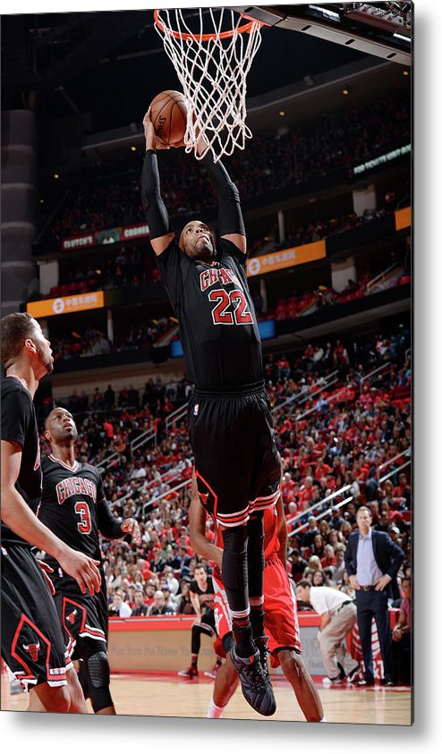 Nba Pro Basketball Metal Print featuring the photograph Taj Gibson by David Dow