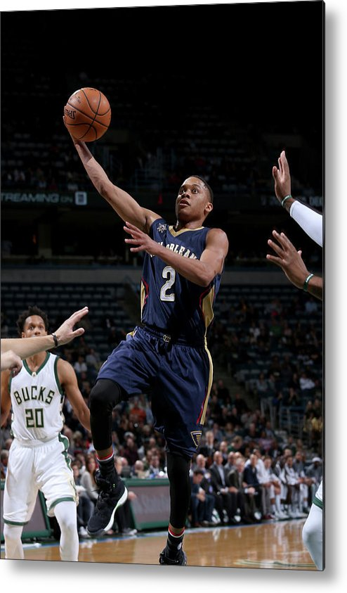 Nba Pro Basketball Metal Print featuring the photograph Tim Frazier by Gary Dineen
